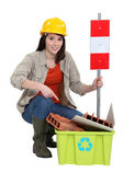 Female construction worker warning you to recycle old material — Stock Photo