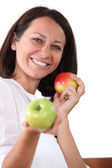 Woman with apples — Stockfoto