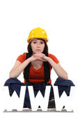 Female builder sat by letters — Stock Photo