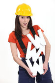 Female builder holding large WWW letters — Foto de Stock
