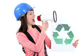 A female construction worker promoting recycling. — Stock Photo