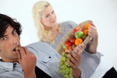 Couple with basket of fruit — Stock Photo