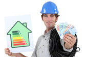 Electrician showing banknotes — Stock Photo