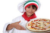 Child cook pizza — Stock Photo