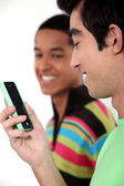 Teen male teenagers looking at text message — Stock Photo