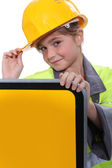 Girl with yellow helmet — Stock Photo