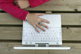Woman's hand on a laptop — Stock Photo