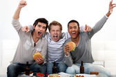 Friends watching a football game together — Foto Stock