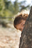 Girl playing peekaboo — Stock Photo
