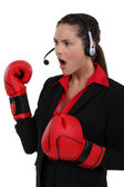 A businesswoman with boxing gloves on. — Stock Photo