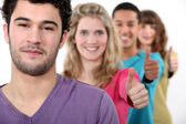 Young group of giving the thumb's up — Stock Photo