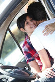 Embracing couple in car — Stock Photo