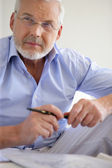 Pensive gray-haired man — Stock Photo