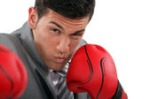 Businessman throwing punches — Stock Photo