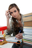 Student surrounded by books — Stock Photo