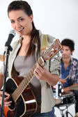 Woman with acoustic guitar — Stock Photo