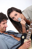 A female singer and a guitarist — Stock Photo