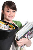 Young woman recycling paper — Stock Photo