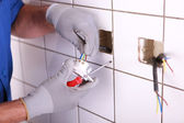 Hands of electrician — Stock Photo