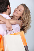 Cuddle with shopping bags — Stock Photo