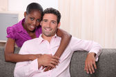 Mixed race couple at home — Stock Photo