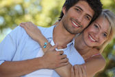 Couple stood close to each other in park — Stock Photo