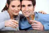 Couple drinking champagne to celebrate anniversary — Stock Photo