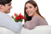 Man giving flowers to his girlfriend — Foto Stock
