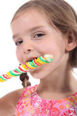 Cute kid with a swirly lolly — Stock Photo