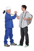 Tradesman making a pact with a young man — Stock Photo