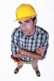 A dubious construction worker. — Stock Photo