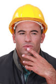 Portrait of a doubting tradesman — Stock Photo