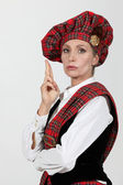 Woman in Scottish costume — Stock Photo