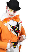 Man maked up wearing a grotesque clown costume and a bowler — Stock Photo