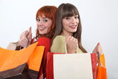 Young women on a shopping spree — Stock Photo