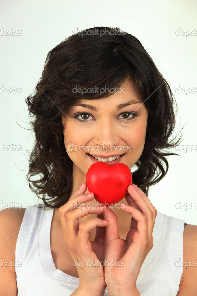Young woman with red heart in hand — Stock Photo #11846790