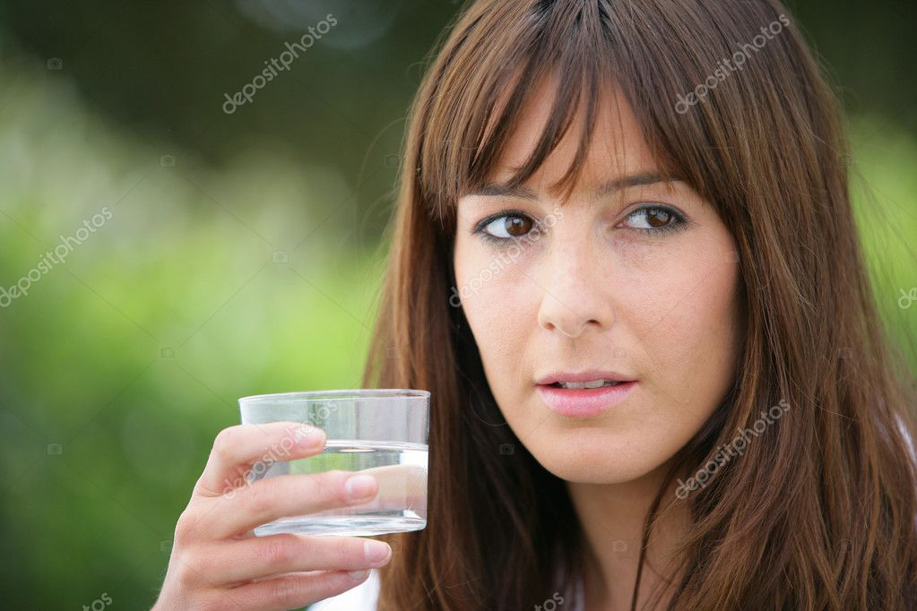 Brunette holding a glass of water  Stock Photo #11847136