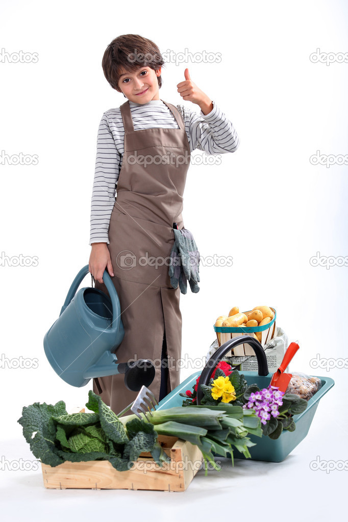 A little boy dressed in gardener — Stock Photo #11847299
