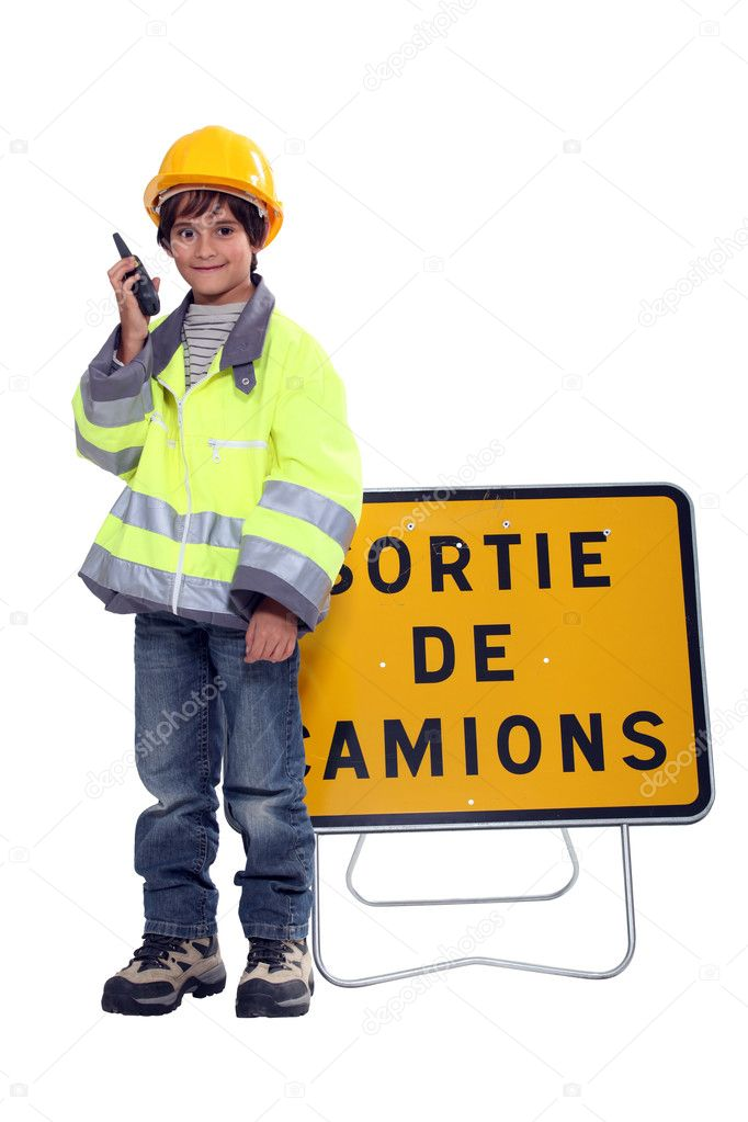 Young boy pretending to be a traffic guard  Stock Photo #11847320