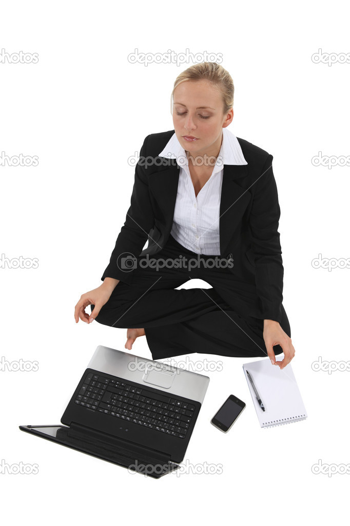 Businesswoman sat in yoga position — Stock Photo #11847570