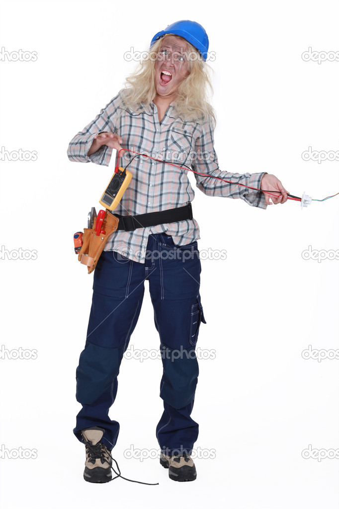 Shocked female electrician — Stock Photo #11847634