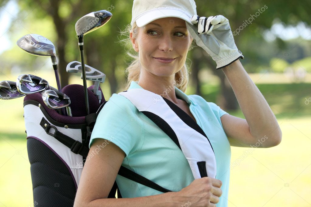 A smiling female golfer. — Stock Photo #11847802
