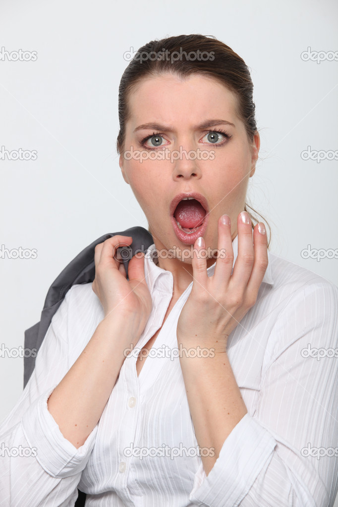 Young businesswoman shocked expression on face — Stock Photo #11848479
