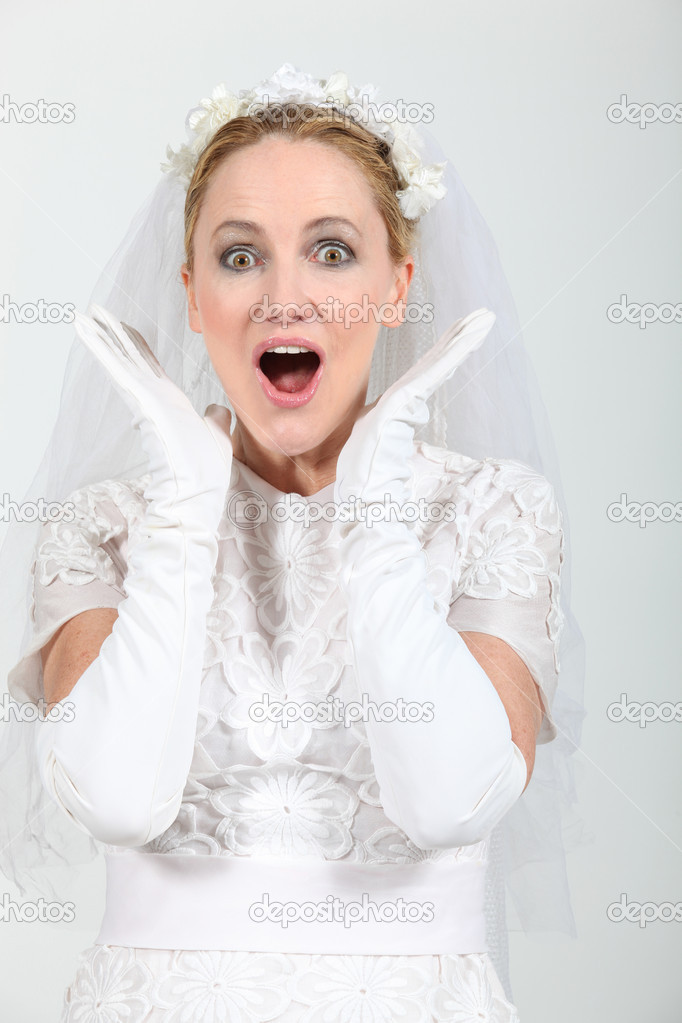 Blond woman dressed in wedding dress — Stock Photo #11849004