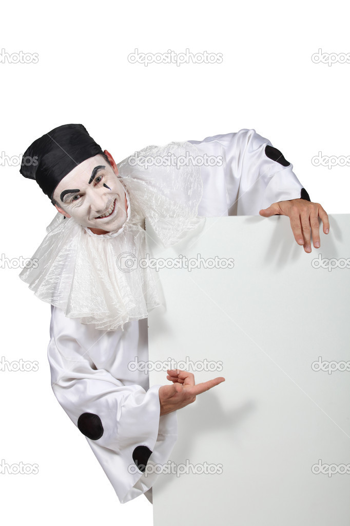 Harlequin pointing white panel — Stock Photo #11849036
