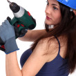 Woman with drill — Stock Photo #11853843