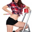 Sexy woman on a ladder painting - Stok fotoğraf