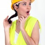 Woman with yellow helmet — Stock Photo