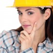 Tradeswoman contemplating life - Stock Photo