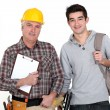 Builder welcoming trainee — Stock Photo